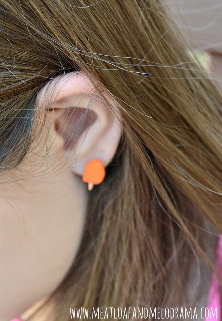 girl wearing polymer clay popsicle earrings