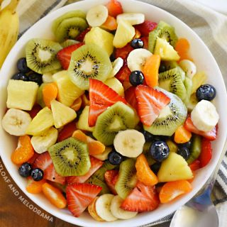 summer fruit salad in white serving bowl