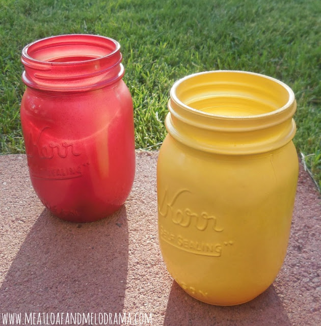 red and yellow spray painted mason jars