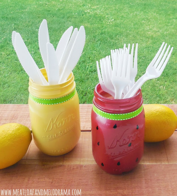 lemon and watermelon mason jars holding forks and knives