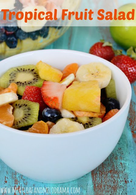 fruit salad with honey lime dressing in a bowl