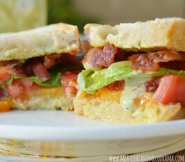 blt sandwich with heirloom tomatoes, bacon, lettuce on sourdough bread