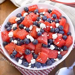 watermelon, feta and blueberry salad in white serving bowl
