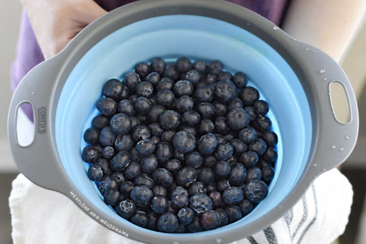 blueberries in a blue collender