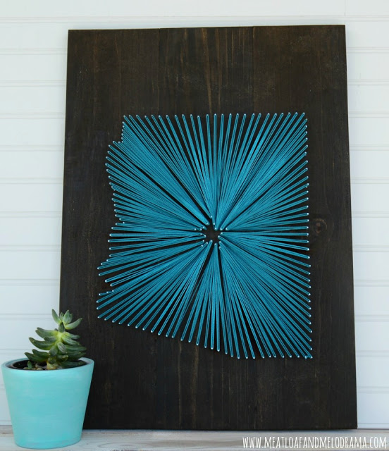 Arizona string art made with aqua string on dark wood background