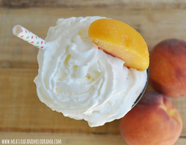 copycat chick-fil-a peach milkshake topped with whipped cream and a peach