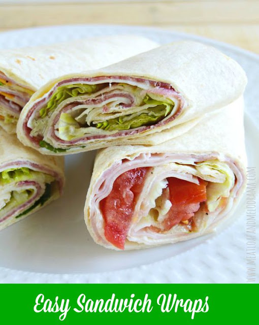 ham and salami wraps with cheese, lettuce and tomatoes