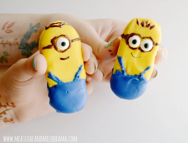 two decorated minion cookies