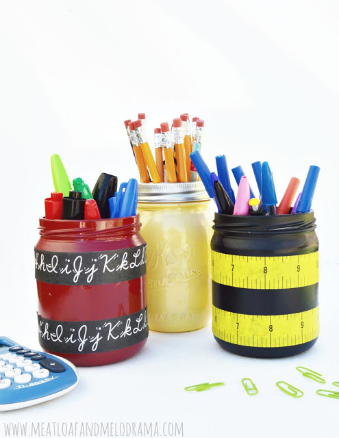 mason jars painted and decorated with scotch masking tape for holding school supplies