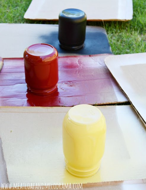 spray paint mason jars with yellow and red and black