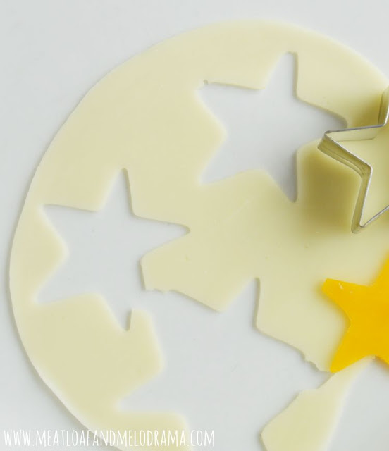 cut stars out of cheese with star cutter