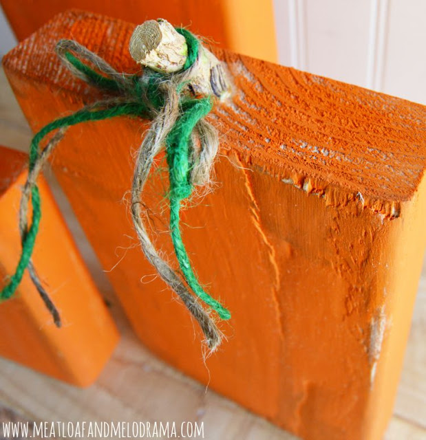 twine leaves on wood pumpkins