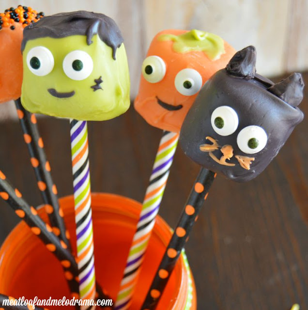 Frankenstein and pumpkin and black cat dipped marshmallows for Halloween