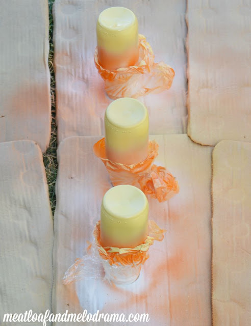 orange yellow and white spray paint on glass bottles to make candy corn