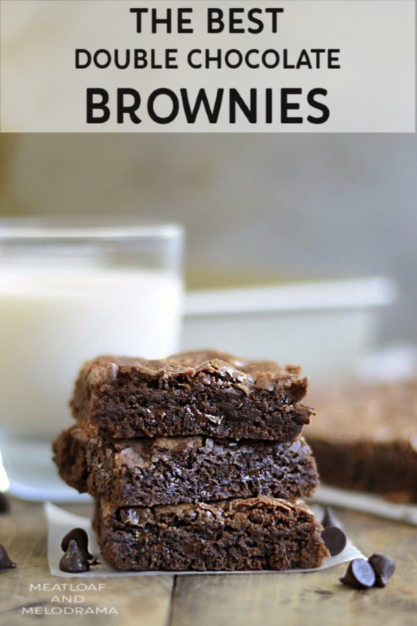 double chocolate brownies stacked with glass of milk