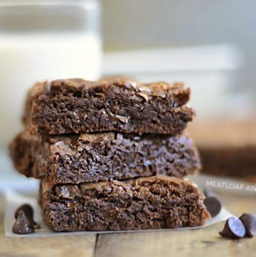 three fudgy chewy double chocolate brownies with chocolate chips brownies stacked