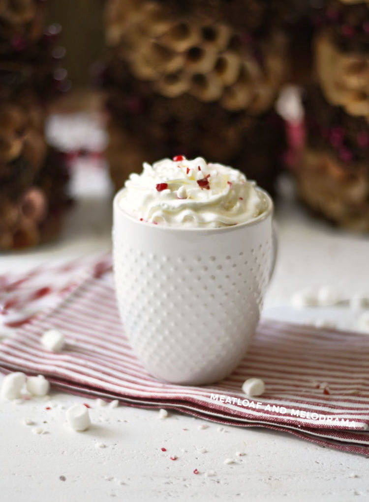 homemade peppermint hot cocoa with whipped cream in white mug