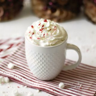 peppermint hot cocoa with whipped cream in a white mug