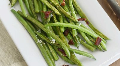 sauteed green with bacon and lemon on serving platter