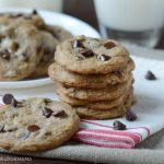 best chocolate chip cookies stacked on a plate with milk
