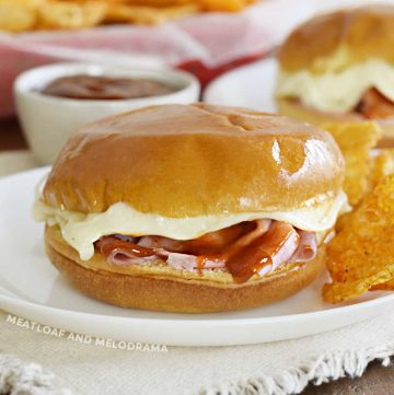 baked ham and cheese sliders with bbq sauce and melted provolone cheese