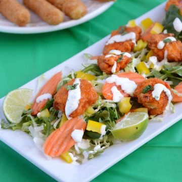 boneless-buffalo-chicken-bites-over-fresh-greens-with cilantro-lime-dressing
