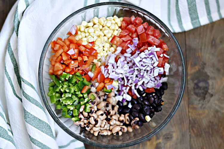 ingredients for cowboy caviar in mixing bowl
