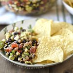cowboy caviar with tortilla chips on a saguaro cactus plate