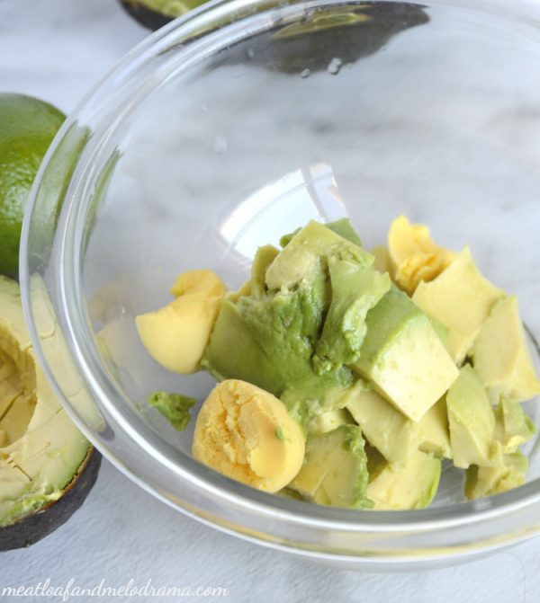 avocado and egg yolks in mixing bowl