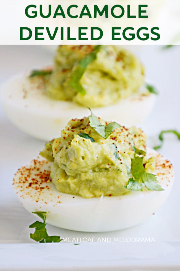 guacamole avocado stuffed deviled eggs on a platter