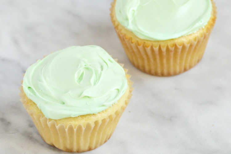 yellow cupcakes with light green frosting