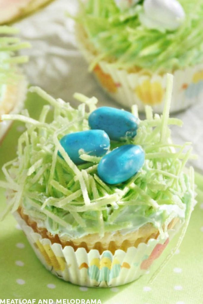 easter cupcakes topped with edible easter grass and mini candy eggs