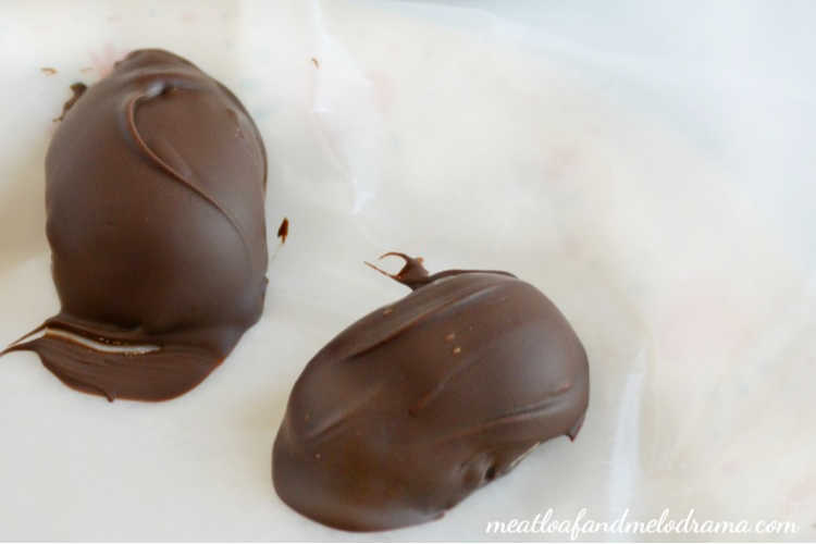 chocolate dipped peanut butter eggs on wax paper to dry