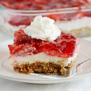 strawberry pretzel salad on a white plate