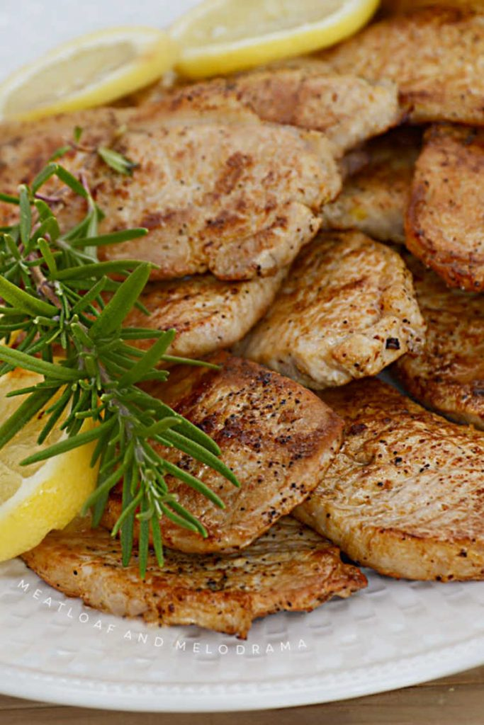 grilled lemon rosemary pork chops on platter