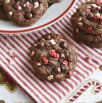 peppermint mocha cookies with peppermint chips on a red and white napkin