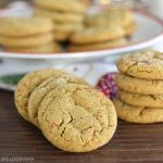 soft molasses cookies with red sugar sprinkles stacked and on a plate