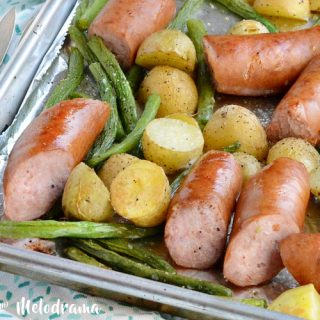 sheet pan smoked sausage dinner with potatoes and green beans