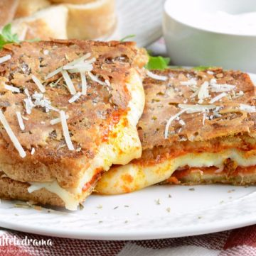 Parmesan crusted pepperoni pizza grilled cheese sandwich on plate