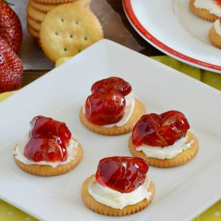 ritz crackers with strawberry pie filling and cream cheese