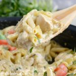one pot salsa verde chicken pasta on wooden spoon