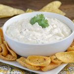 creamy salsa verde dip in bowl with chips