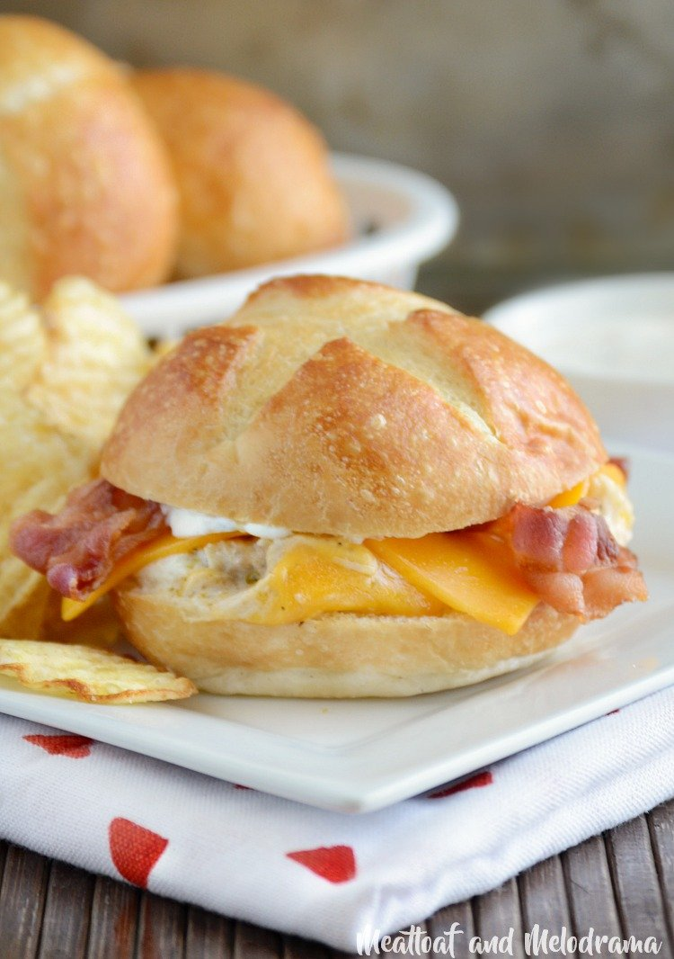 crock-pot chicken bacon ranch sliders on plate with chips