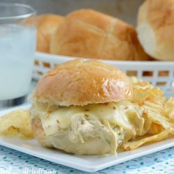 crock pot salsa verde chicken sliders on plate with chips