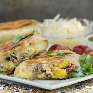 crispy salsa verde breakfast burritos with sausage eggs and peppers