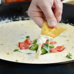 salsa verde white queso dip in skillet