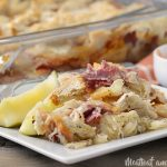 easy baked reuben casserole on a plate with pickles