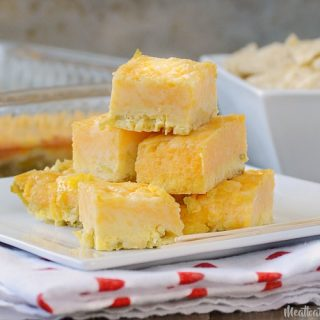 green chile cheese squares appetizer on a white square plate