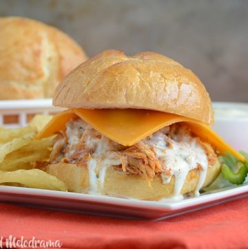 crock pot honey buffalo chicken sliders with ranch dressing and celery sticks