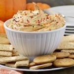 pumpkin pie dessert dip with gingersnaps and graham crackers in a bowl